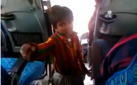 A Kid Dancing And Acting For Money In A Bus