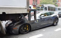 Crunch! Brand new $300,000 Ferrari gets backed over by a delivery truck and then gets a ticket for double parking