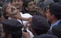Supporters of the political party Tehreek-e-Insaf scuffle with police blocking them from reaching the U.S. embassy, during  protest against the accused killing of Pakistanis by a U.S. consulate employee during a demonstration in Islamabad